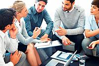 Business woman discussing project with colleagues during meeting