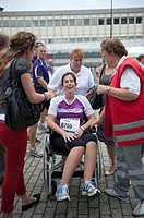A young atlete is brought to the first aid in a wheelchair, after finishing the Tilburg Ten Miles marathon in september 2011.