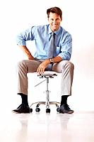Portrait of a successful young businessman sitting on the chair