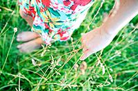 Woman Touching Grass