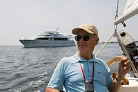 captain of a small sailing ship on Long Island sound off Stonington, CT, USA