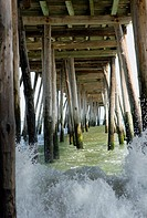 raging surf under the pier in Kill Devil Hills, NC, USA