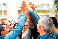 Group of business people high_fiving one another