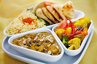 Indian set lunch meal  Sag mushroom korma and vegetable balti