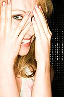 Laughing Woman Peeking Through Her Hands