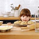Girl with Cookies in Kitchen
