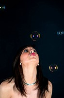 Pretty woman in a studio with bubbles
