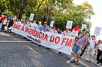 Demonstrators carry a banner stating 'No to IMF (in portuguese: FMI) interference' in the demonstration against the IMF, the Troika, the Austerity Pla...