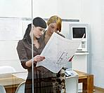 Two Women Looking at Architectural Plan