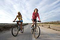 Two Young Women Cycling