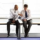 Businessmen Sitting on Table
