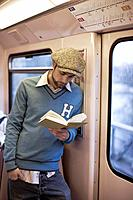 Man Reading Book in Subway