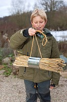 boy collecting material for building a insect hotel, Germany
