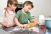 Brother and Sister Rolling Dough