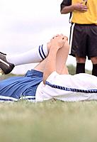 Soccer Player Stretching on Field