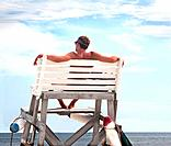 view from back of lifeguard in high wooden lifeguard stand