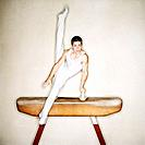 Athletic Young Man on Pommel Horse