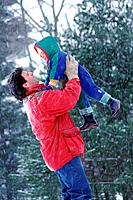 Father and child playing in the snow