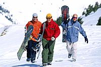 Men Walking with Snowboards