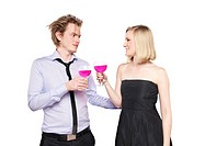 Young couple toasting with pink drink