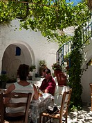 Couple in the shade of the Matina Taverna Restaurant in Komaki Village on the Greek island of Naxos