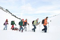 group of teenagers on a winterly mountain hiking