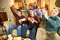 Family Cheering While Watching Football Game