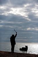 woman and dog at the shore