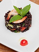 A dish of black rice, shirmos and vegetables