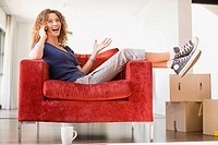 Woman talking on cell phone in armchair