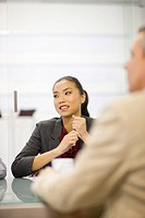 Businesswoman sitting in conference