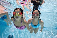 Children with Goggles Swimming Underwater