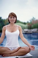 Woman Practicing Yoga by Lake