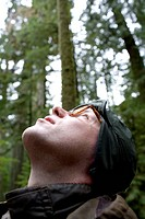 Man Looking Up at Trees, Cathedral Grove, MacMillan Provincial Park, Vancouver Island, British Columbia