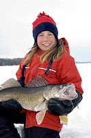 Young Girl Ice Fishing holding a Walleye, Wawa, Ontario