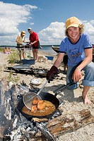 Family Cooking Lunch on a Beach, Wawa, Ontario
