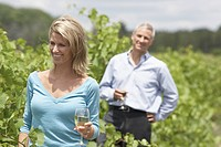 Couple holding Wine Glasses in a Vineyard, Stouffville, Ontario