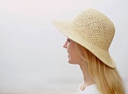 Young woman wearing sunhat