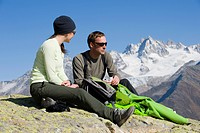 Anne_Sophie Bron and Hamish Moeller taking a break on the trail in Grand Balcon Sud, Chamonix, France.