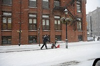 Person using a Snow blower in a Snow Storm, Toronto, Ontario