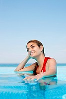 Young woman in swimming pool, portrait (thumbnail)