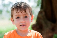 Boy wearing orange t shirt, portrait (thumbnail)