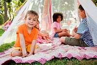 Four friends in summer netting tent (thumbnail)