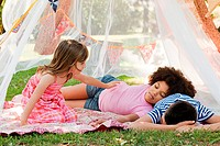 Three friends sleeping in summer netting tent (thumbnail)