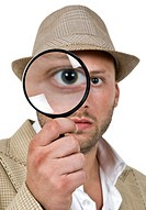 man holding magnifier close to eye