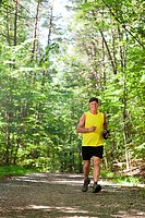 Man running along forest path