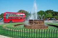 fountain and London bus exhibit Corfu Town Corfu Greece