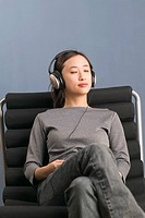 Woman Listening to Music Player