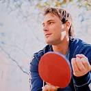 Young Man Holding Table Tennis Paddle
