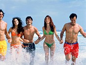 Group of laughing young people in the ocean